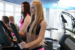 Beautiful girls training endurance at gym - stock photo