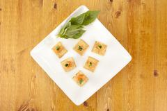 A plate of crackers with smoked salmon Stock Photos