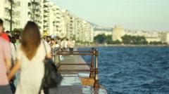 Sea wave splashing in slow motion along a pedestrian zone in Thessaloniki Stock Footage