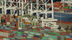 Aerial view of container ship and dock cranes Los Angeles Port USA Stock Footage