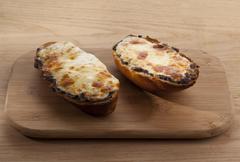 Baked cheesy roll bread Stock Photos