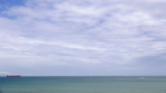 Ship in Weymouth Bay on cloudy day - stock footage