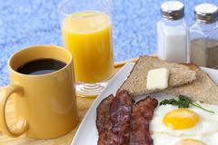 Breakfast on breakfast table Stock Photos