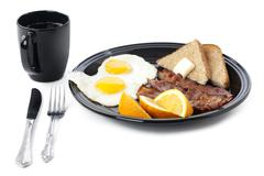 Breakfast plate with cup and fork on white Stock Photos