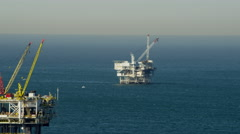Aerial view offshore platform drilling for oil Pacific Ocean California Stock Footage