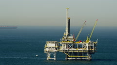Aerial view of offshore gas drilling in Pacific Ocean California Stock Footage
