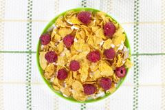 Cereal and raspberries with milk in a bowl Stock Photos