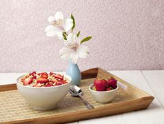 Cereal bowl with strawberres in a tray Stock Photos