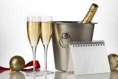 Champagne bottle flutes and ice bucket with christmas baubles Stock Photos