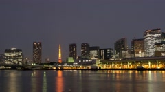 Day to night time-lapse footage of Tokyo tower and cityscape from Sumida river Stock Footage