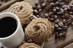 Coffee drink and grains with cookies Stock Photos