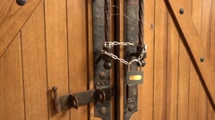 Tilt up door locked on chain and padlock Stock Footage