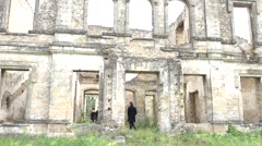 Tilt up tourists visiting ruins Stock Footage