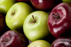 Granny smith and red delicious apples Stock Photos