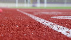 Track runners putting hands at starting line Stock Footage