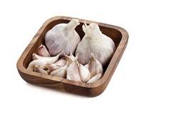 Purple garlic in bowl Stock Photos