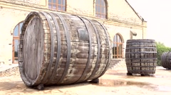 Zoom out big wood casks and house Stock Footage