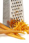 Rub carrots and grater Stock Photos