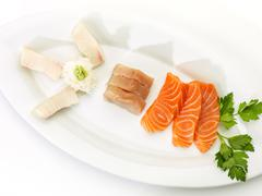 Sliced raw fatty salmon and tuna isolated on white background Stock Photos