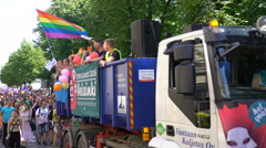 Thousands of people in solidarity during a Gay pride parade on the streets. - stock footage