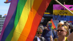 Rainbow flag during a Gay pride parade on the streets of Helsinki. - stock footage