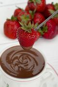 Strawberry with melted chocolate Stock Photos