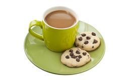 Teacup with chocolate cookies Stock Photos