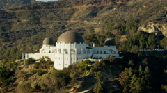 Aerial view of Griffith Observatory and suburbs in California Hills Stock Footage