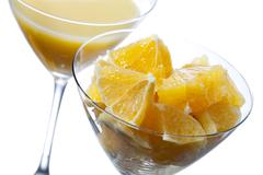 Two martini glass with orange juice and orange slice Stock Photos