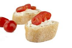 Two slices of bread mayonnaise and tomatoes Stock Photos