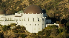 Aerial view at sunset of Griffith Park Observatory Los Angeles Stock Footage