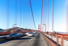 Traffic on gold gate bridge with sunbeam Stock Photos