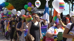 Thousands of people in solidarity during a Gay pride parade on the streets. Stock Footage