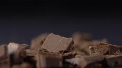 Falling pieces of chopped chocolate Stock Footage