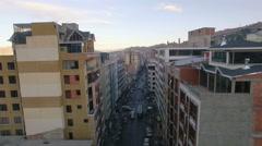 4K aerial view forward above buildings street traffic la paz bolivia Stock Footage