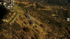 Aerial view at sunset of Hollywood film sign above Los Angeles USA Stock Footage