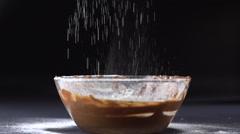 Pouring sugar powder on chocolate Stock Footage