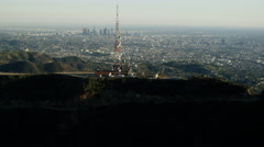 Aerial view of radio mast behind Hollywood sign Los Angeles Stock Footage