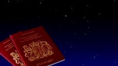 Two British passports with night stars Stock Footage
