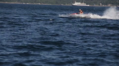 Happy couple riding jet ski - stock footage