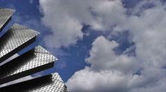 Cloudy blue sky passes behind metal steps Stock Footage