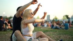 Couple enjoying summer festival Stock Footage