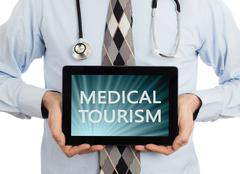 Doctor holding tablet - Medical tourism - stock photo