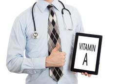 Doctor holding tablet - Vitamin A - stock photo