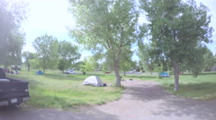 Car driving through campground at Cherry Creek State Park.-POV point of view. Stock Footage