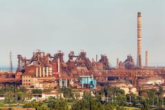 Steel factory with smokestacks at sunset. metallurgical plant. steelworks Kuvituskuvat