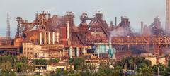 Rusty steel factory with smokestacks at sunset. metallurgical plant Kuvituskuvat