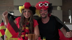 Excited german soccer fan couple cheering for germany Stock Footage