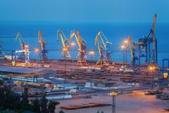 Sea commercial port at night in Mariupol, Ukraine. Industrial view. Cargo Stock Photos