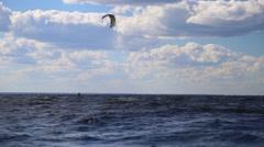 People windsurfing kiteboarding - stock footage